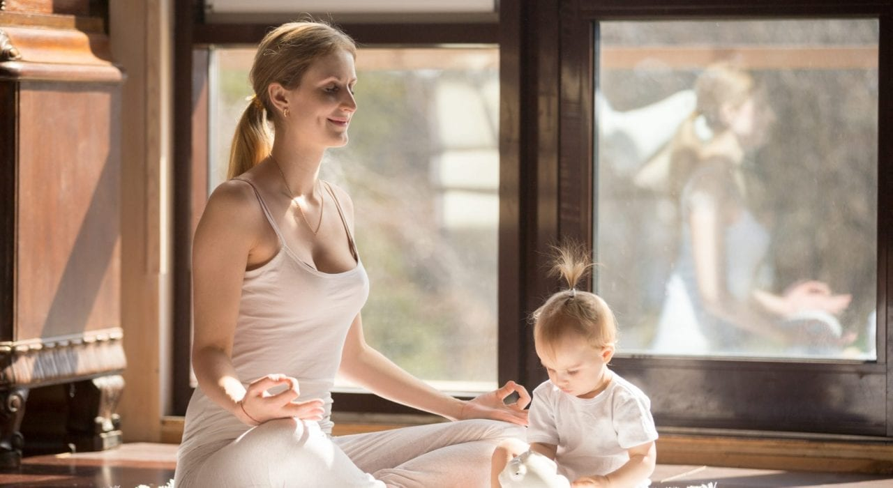 Tips for new mums - Mum doing yoga with baby. Practicing self-care. Tips for new mums