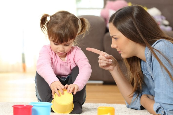 potty training - mother telling daughter off