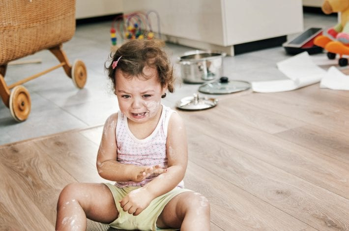 Toddler having tantrum on the floor
