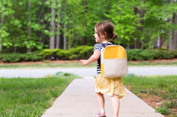 Toddler with backpack ready for nursery school