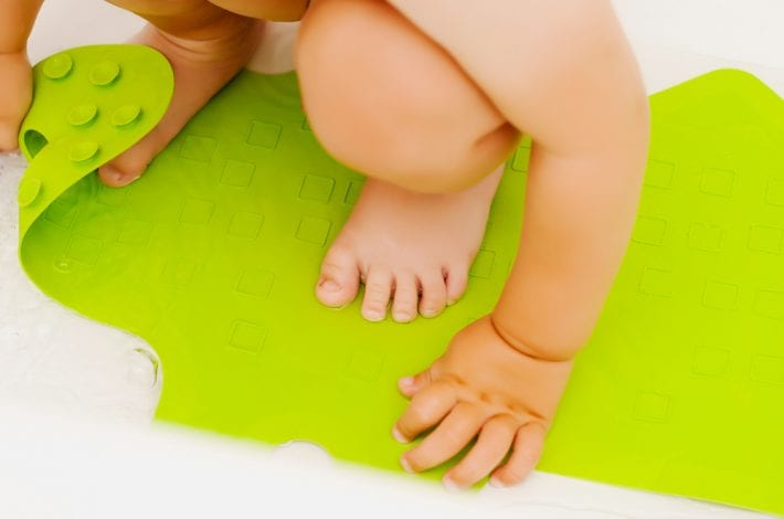 baby on bath mat showing baby safety at bathtime
