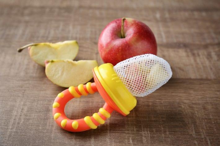 baby teething mesh nibbler with apple chunks