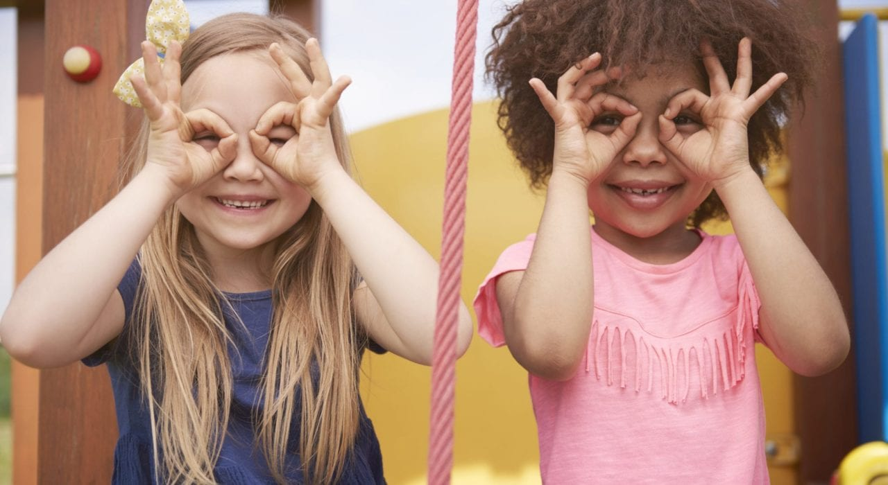 kids to succeed - kids play - girls playing imagination game importance of play