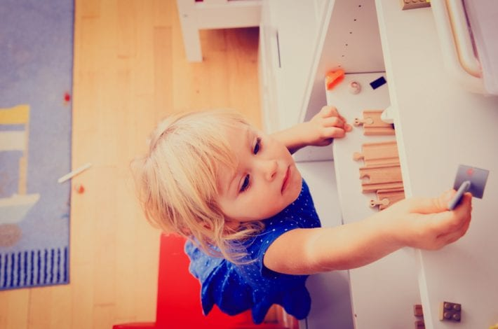 unsecure furniture, toddler climbing to reach something high, danger in the home