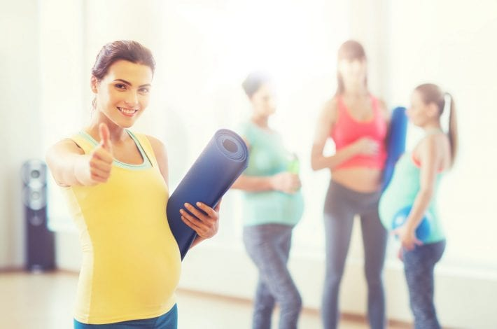 exercising during pregnancy - tips for staying safe - pregnant woman giving a thumbs up