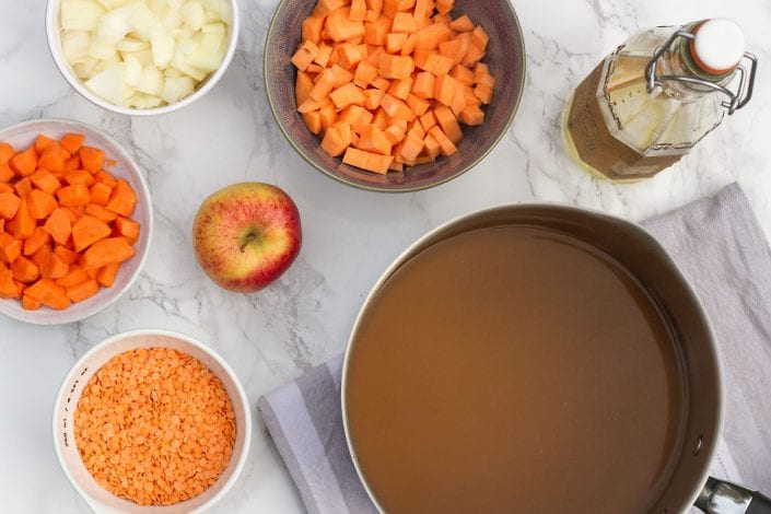 Carrot and lentil soup, cooked with sweet potatoes and apples to make this tasty family dinner dish