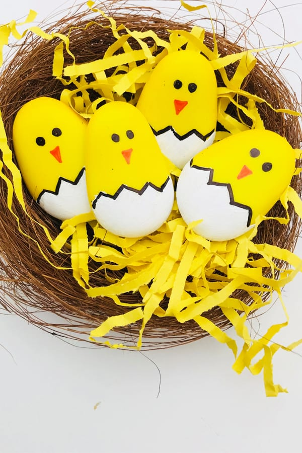 Easter rock painting - make these great easter chicks by painting pebbles - a great easter craft for kids