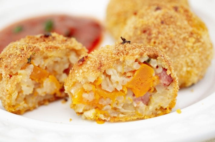 Make these delicious arancini rice balls made with squash and pancetta risotto. Perfect for kids dinners or to use up leftover risotto