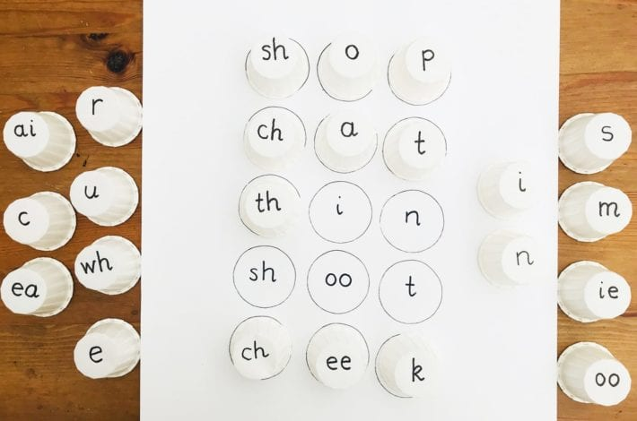 Montessori alphabet game. Try this spelling cups game to help your child practice spelling and phonics