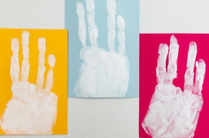 Easter handprint craft - make these cute little hand print Easter bunnies with this fun toddler craft