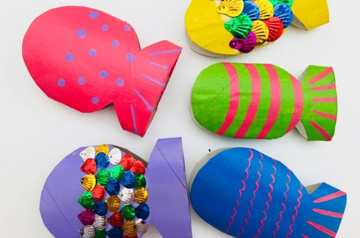 Rainbow toilet roll fish - make these colourful and shiny rainbow fish using recycled toilet rolls . A great summer craft for kids.