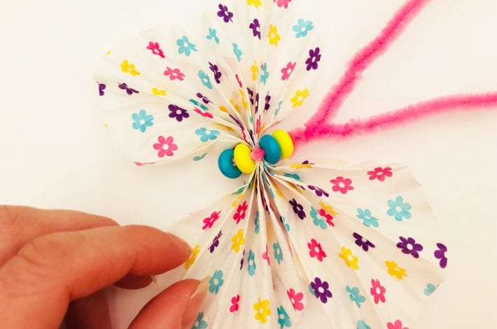 Cupcake liner butterflies that take just 5 minutes to make. A fun spring craft that kids can enjoy.