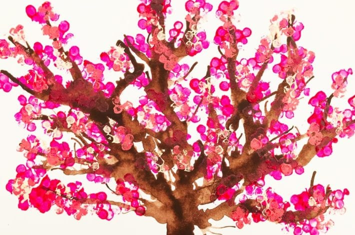 Cotton bud tree art. Make these blow paint and cotton bud printed cherry tree paintings - a great spring craft for kids